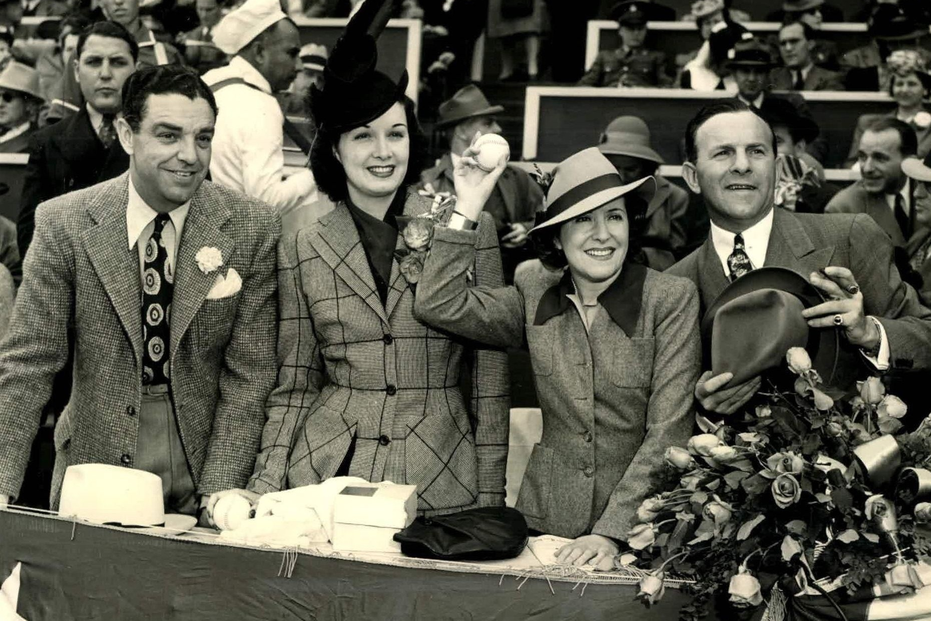 From left, Bob Cobb, Gail Patrick, Gracie Allen, and George Burns at a Hollywood Stars game. Photo via The Sporting News Collection Archives (c. 1940).