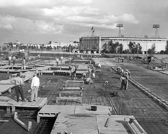 Construction of CBS Television City, with Gilmore Field visible in the background. Photo via CBS Broadcasting Inc. (c. 1957-58)