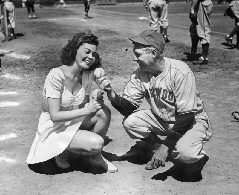 Caption reads: Patricia Mace, Hale America Girl, who will officiate at the opening of the local baseball season, gets a lesson on baseball from Oscar Vitt, Hollywood Stars Manager (via Los Angeles Public Library, Herald Examiner Collection, March 31, 1942).
