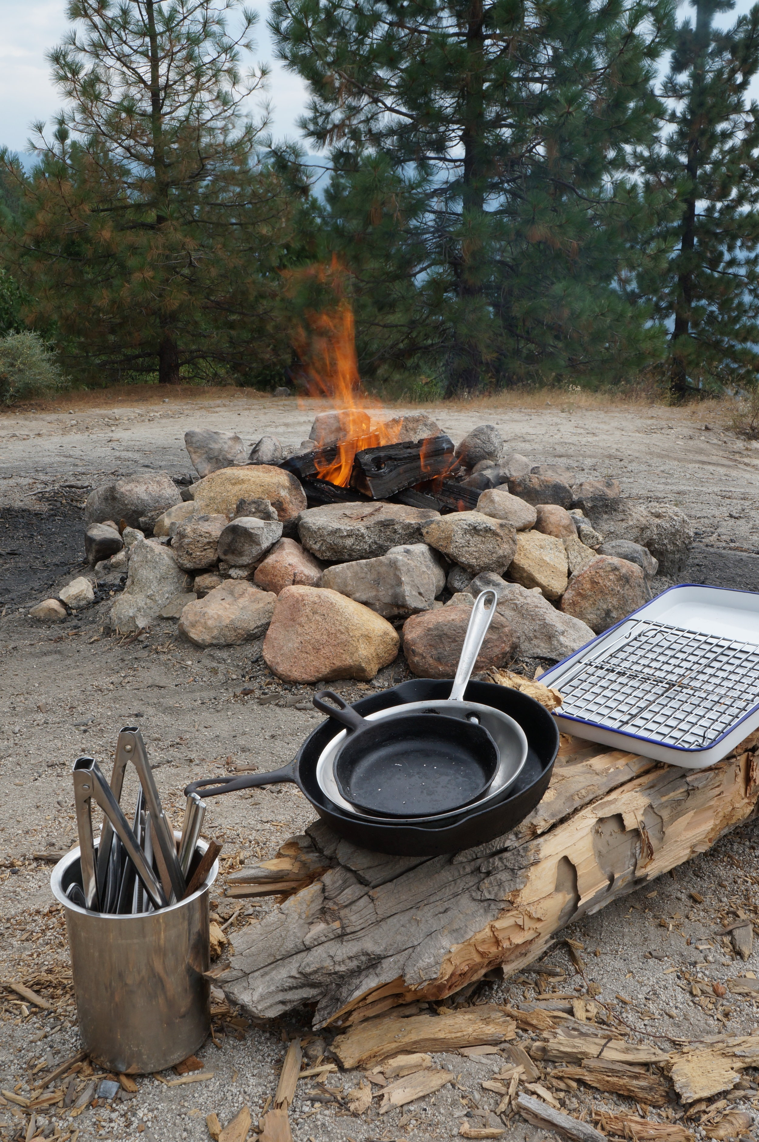 things with which we have a healthy obsession, fire, tongs,cast iron pans