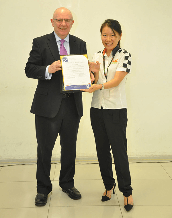 ASIC CEO Mr Maurice presenting Ms Adelaine with the premier status accreditation