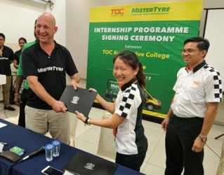 Photo: Adelaine Foo, CEO of TOC Automotive College, exchanging agreement documents for the internship programme with Dennis Melka, Executive Director of MisterTyre.   Image from: Motor Trader