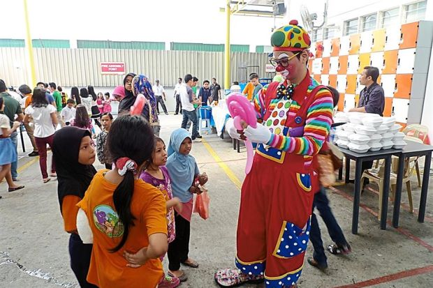 Photo:The clown was a hit with the children. Source:  The Star Online