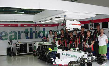 Once-in-alifetimeexperience:TOC winnerscelebratingtheir win in theHonda F1 pit.  Image from:  The Star Online