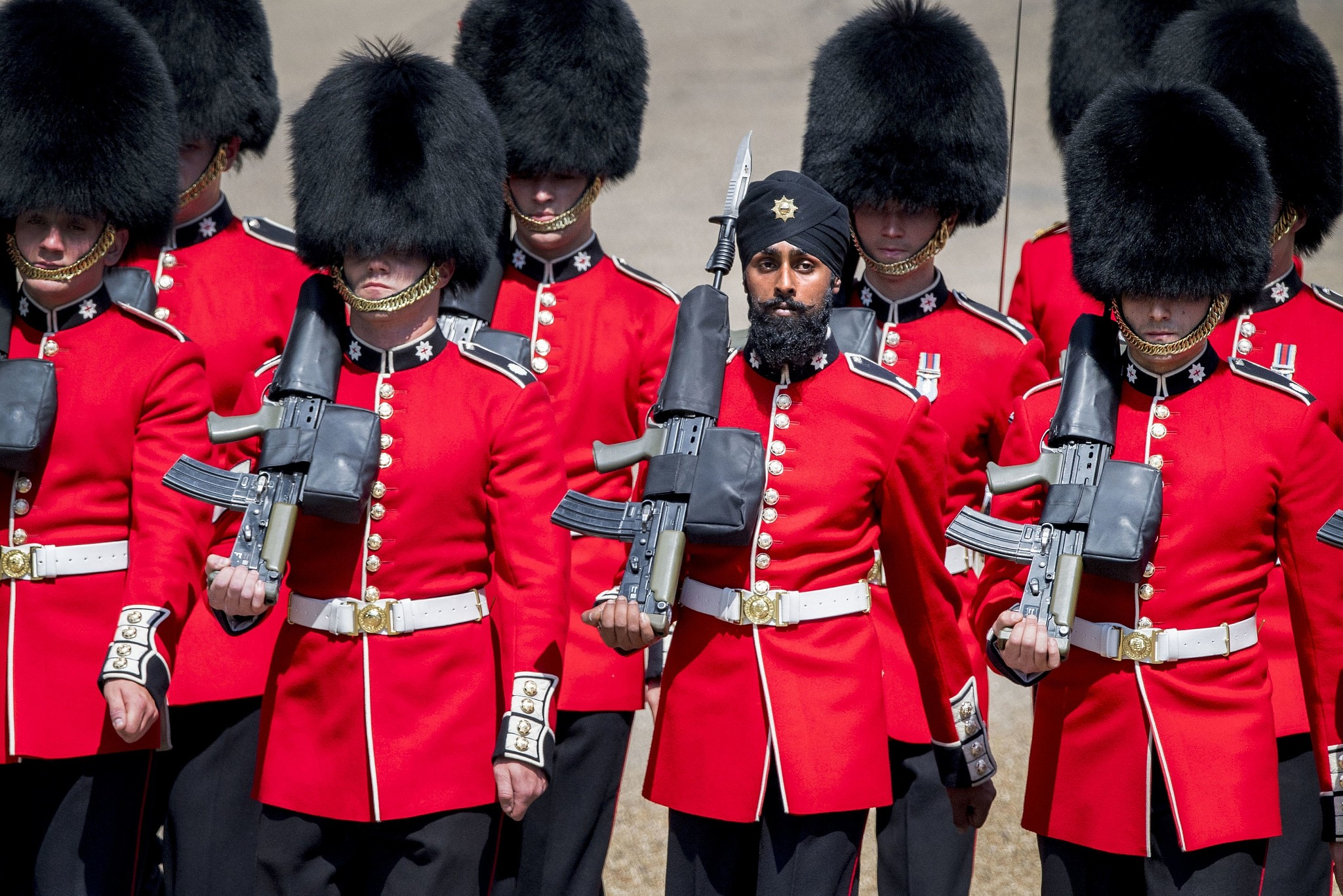 An inspirational picture of diversity in action at the Traditional Queen's Birthday 'trooping of the colours'.