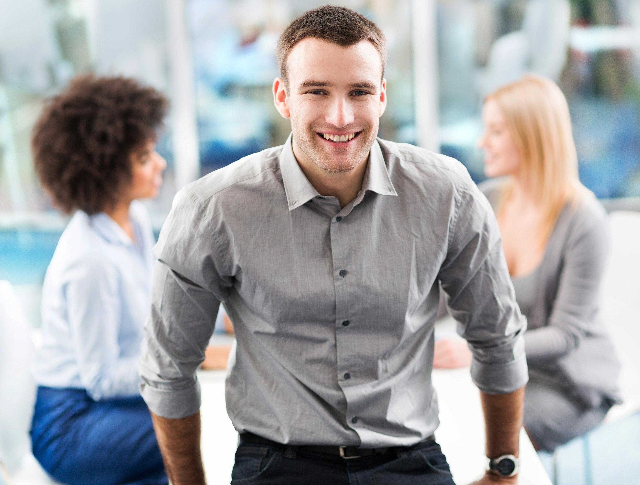 Businessman-with-his-team-498605260_3627x2750.jpeg