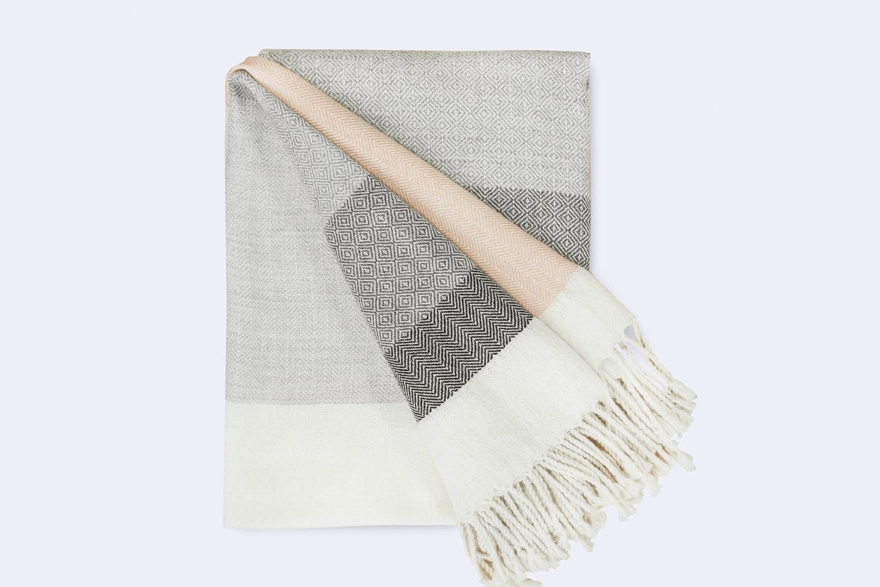 the stuff:Glam up your next Netflix binge and give your living room that instant done-but-not-too-done touch with this exquisite alpaca throw.  Each stripe features a different weaving technique, highlighting both the skills and the artistry of the talented Peruvian weavers who crafted this throw in their remote village in the Andes.  The touch of blush feels fresh and on-trend with our favorite designers, not to mention our favorite Rosé. - Photo by The Citizenry (website)