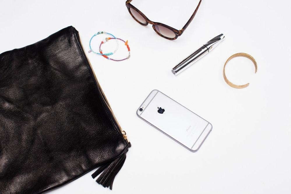 the stuff:You want to be the girl who doesn't carry a purse, but you don't want to be the girl who spills the contents of her wallet and shatters her phone screen on the asphalt while crossing the street on Saturday night. Enter the chic Mulu Clutch from Parker Clay. Small enough to tuck under your arm, but big enough to hold all the essentials; carry it on its own or toss it in your tote when you've got your laptop in tow. Either way, you've got style in the bag. - Photo by Parker Clay (website)