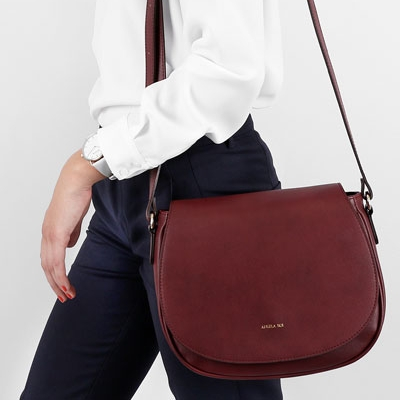 Photo by Angela Roi (note: the bag pictured here is the more muted Bordeaux shade - the Scarlet bag ships November 28th and can be preordered now)