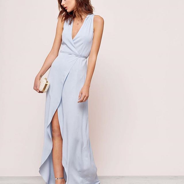 Sky blue is not a color that we would normally choose for, well, anything.  But this simple yet decidedly feminine wrap dress has us rethinking our monochromatic ways.  That slit, you guys!  We're loving its  flower petal vibe and how it sort of ripples to the floor.  Maybe it's more like a wave than a flower?  Who cares, we love both.  We also love that @mickeyandjenny makes every garment they sell in their factory in California using eco-friendly and sustainable fabrics and dyes.  In addition to the Suzette style (pictured), they have several other event-ready dresses that are sure to make you the talk of the party.  Check our our latest Edit for this and 5 other must haves for your next weekend away! {link in profile}