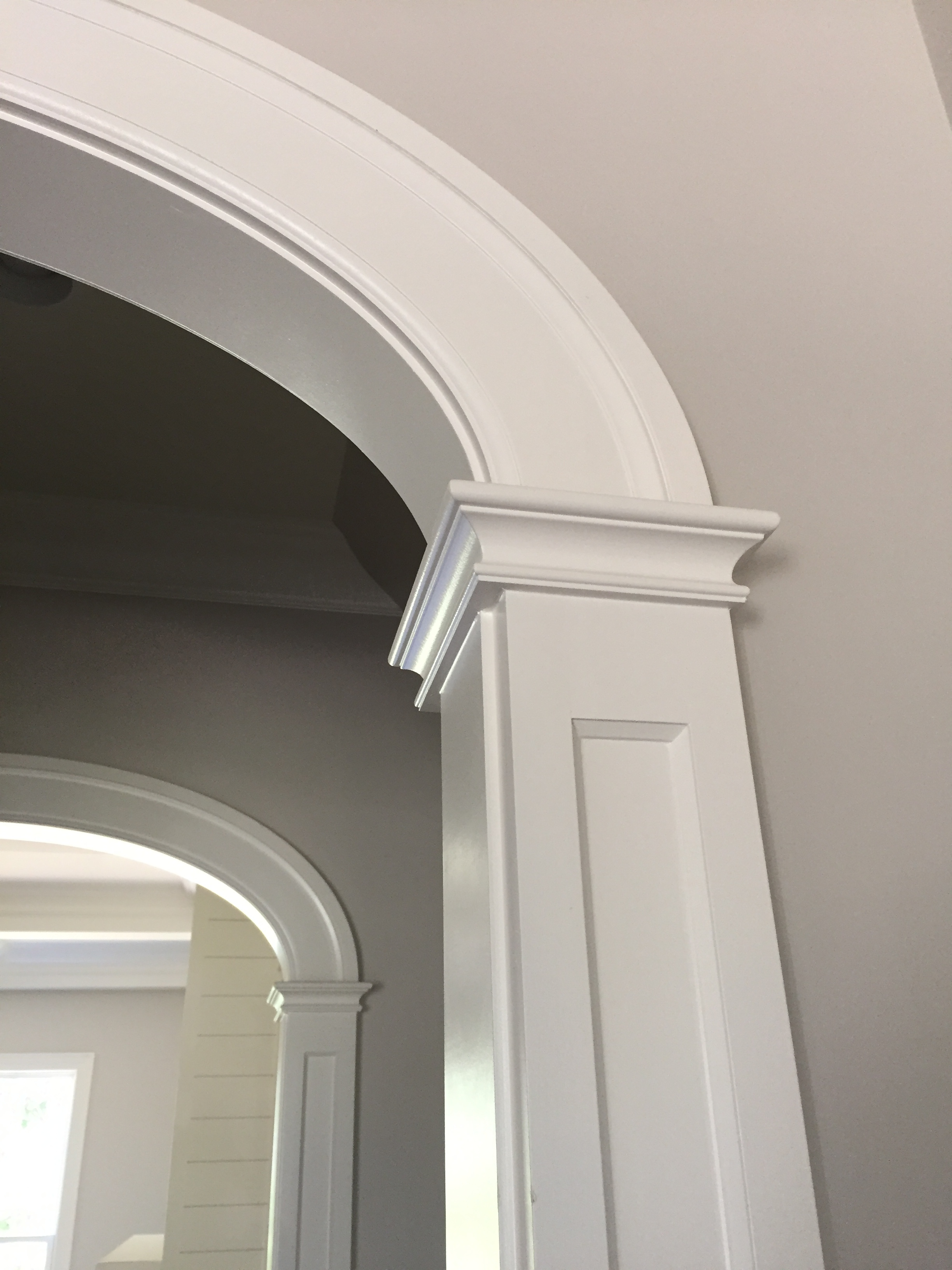 "farmhouse style arched opening - frame and flat panel column detail - 5"" wide casing detail"