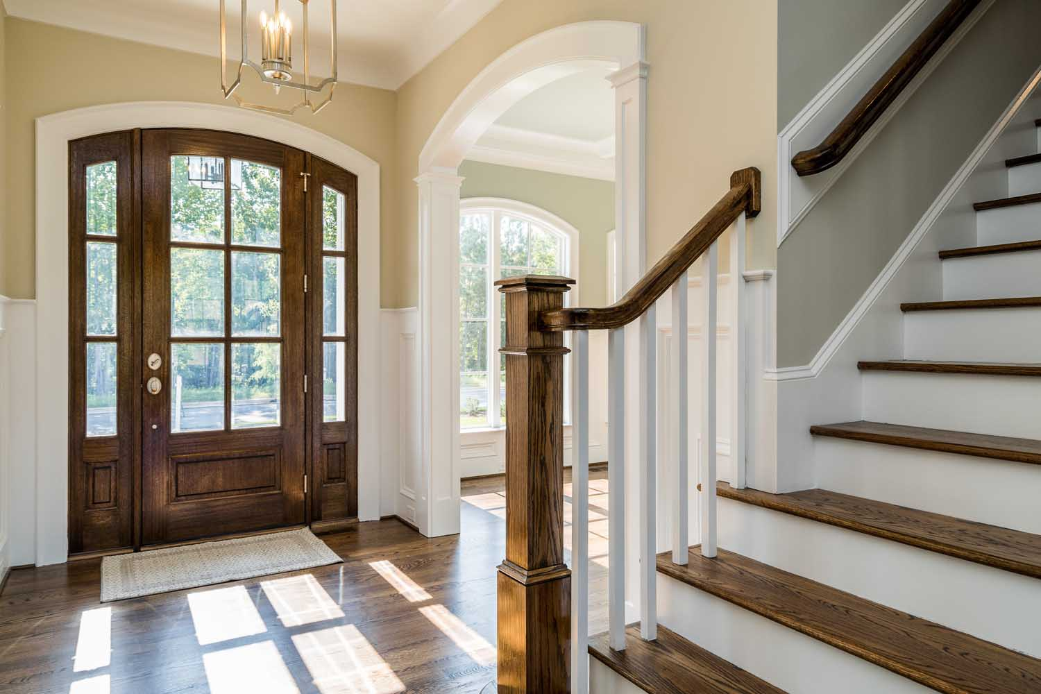 arched openings in entry, solid radius arch door trim