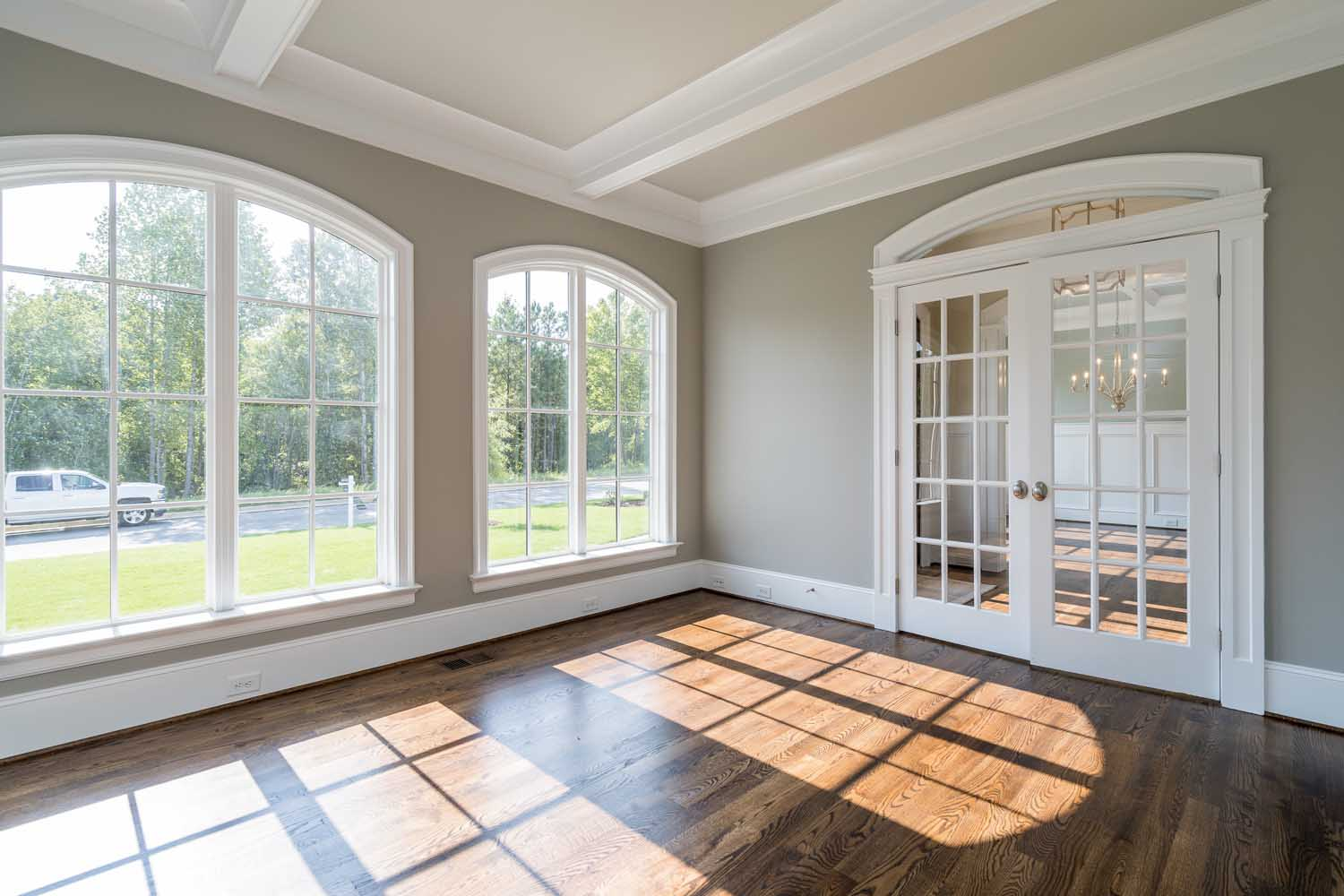 Radius Arch Transom over French doors in home office, solid arch window casings