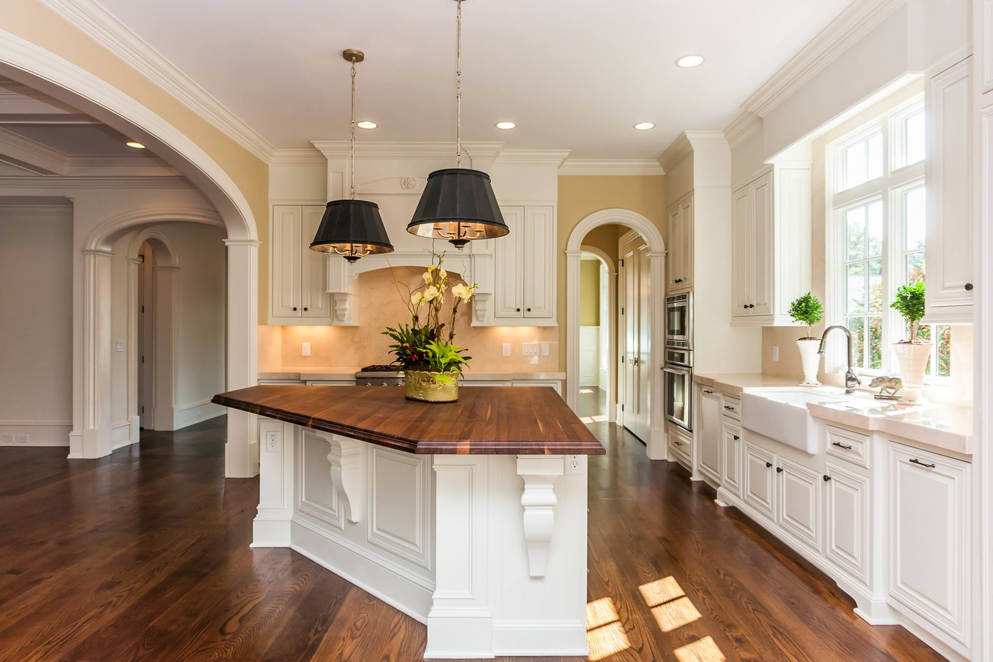 "arched openings in traditional home - wood island top - 5"" casing width - no keystones"