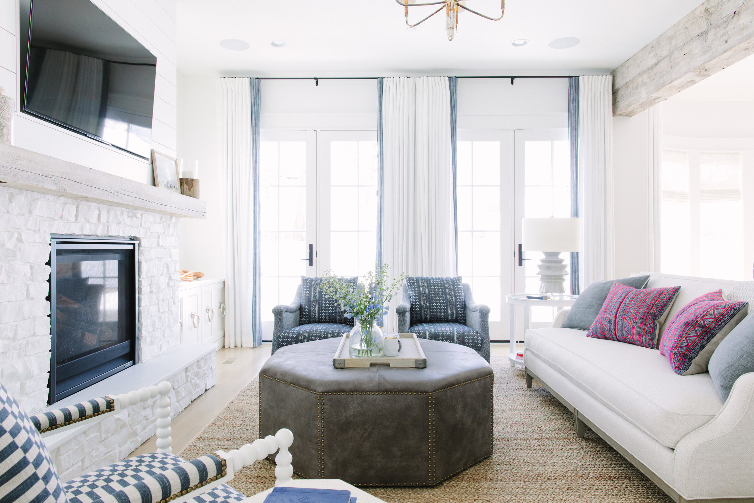 A  large natural fiber rug  adds warmth and texture to any room like in the family room at our  #yesifitswhiteclient project