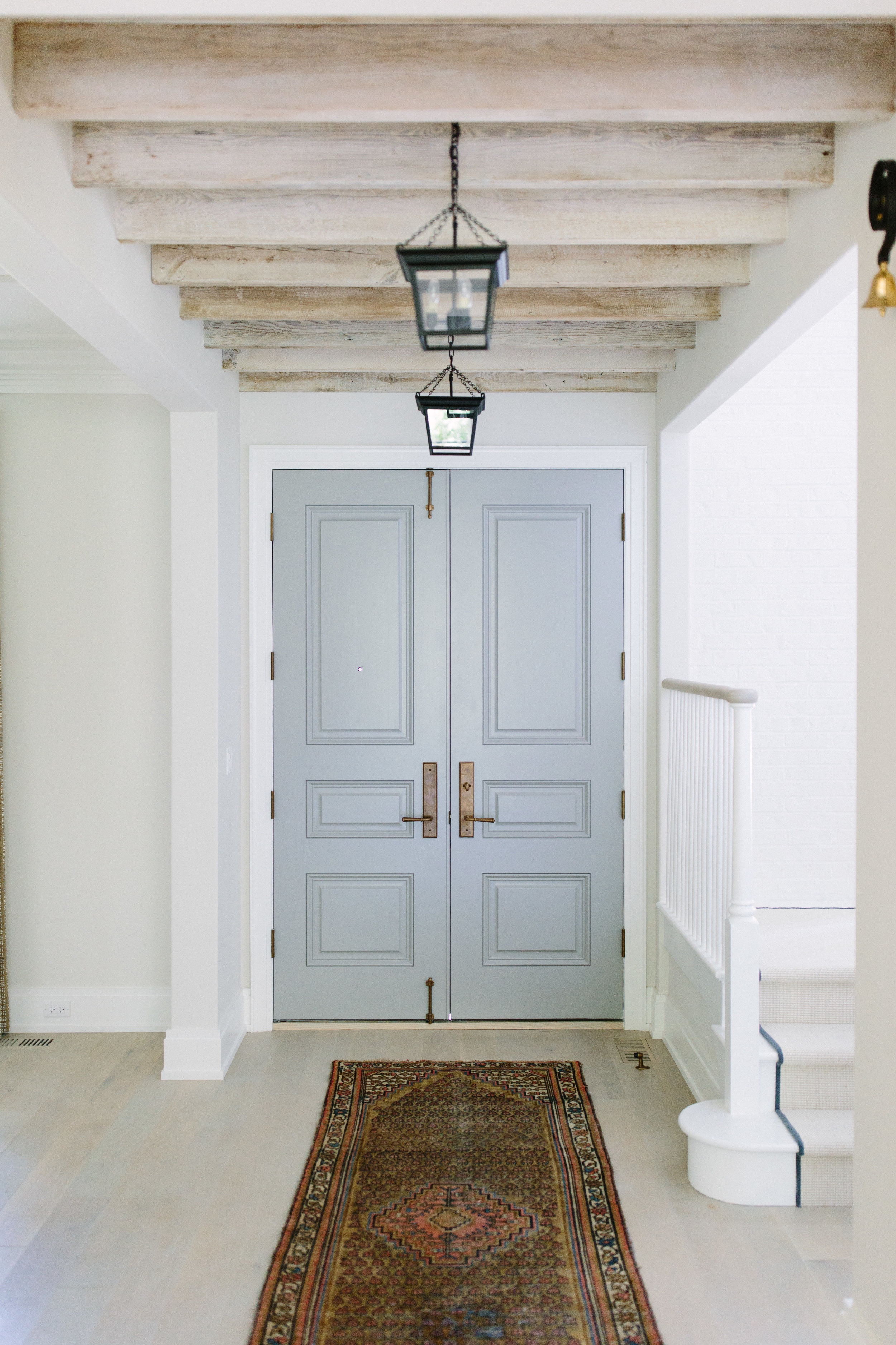 What is the color of these doors?These doors from out Grey Oak Project are actually not a light blue- they are actually Cape May Cobblestone by Benjamin Moore -