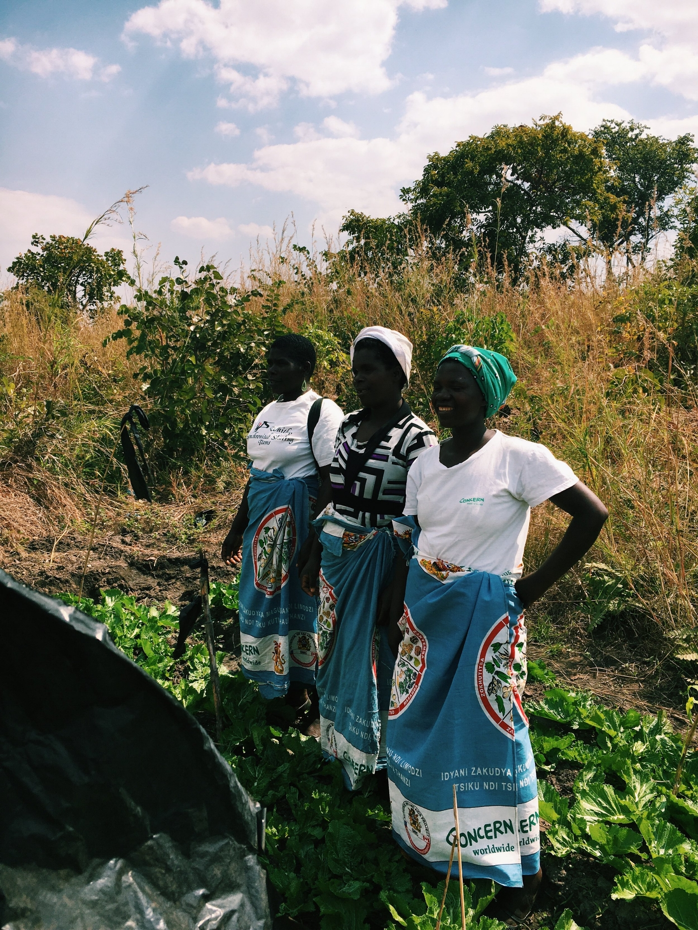 three Lead Mothers stand proudly in their Kitchen Garden, Mchinji District