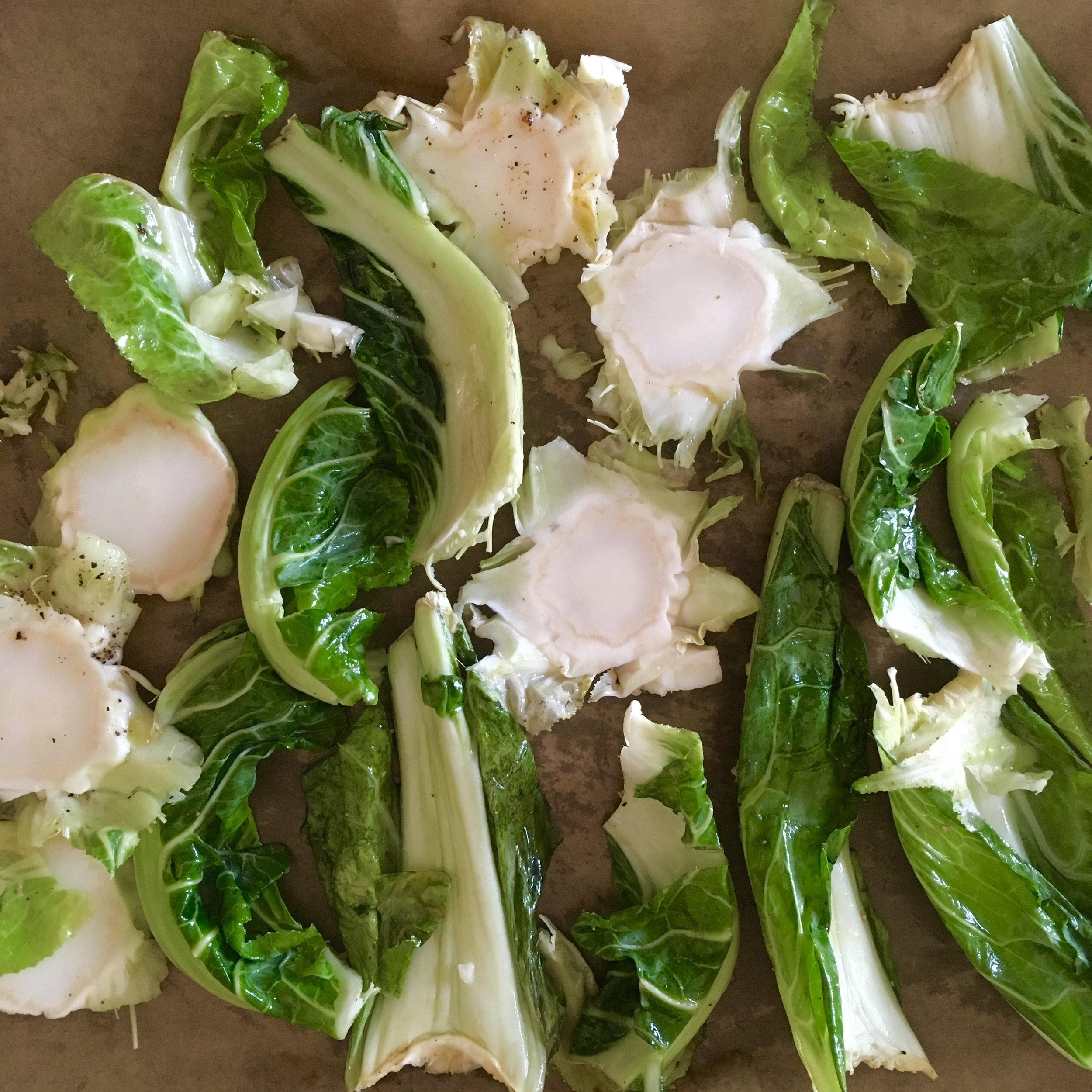Leaves and stems tossed in some olive oil and about to be roasted in the oven. Looking better already…