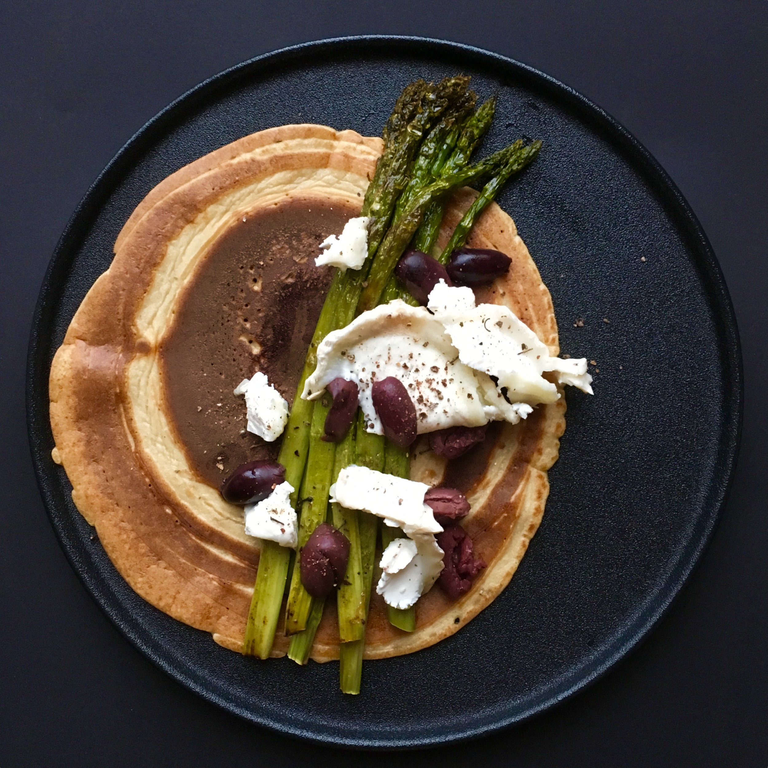 Sourdough pancakes filled with goats cheese, roasted asparagus and olives.