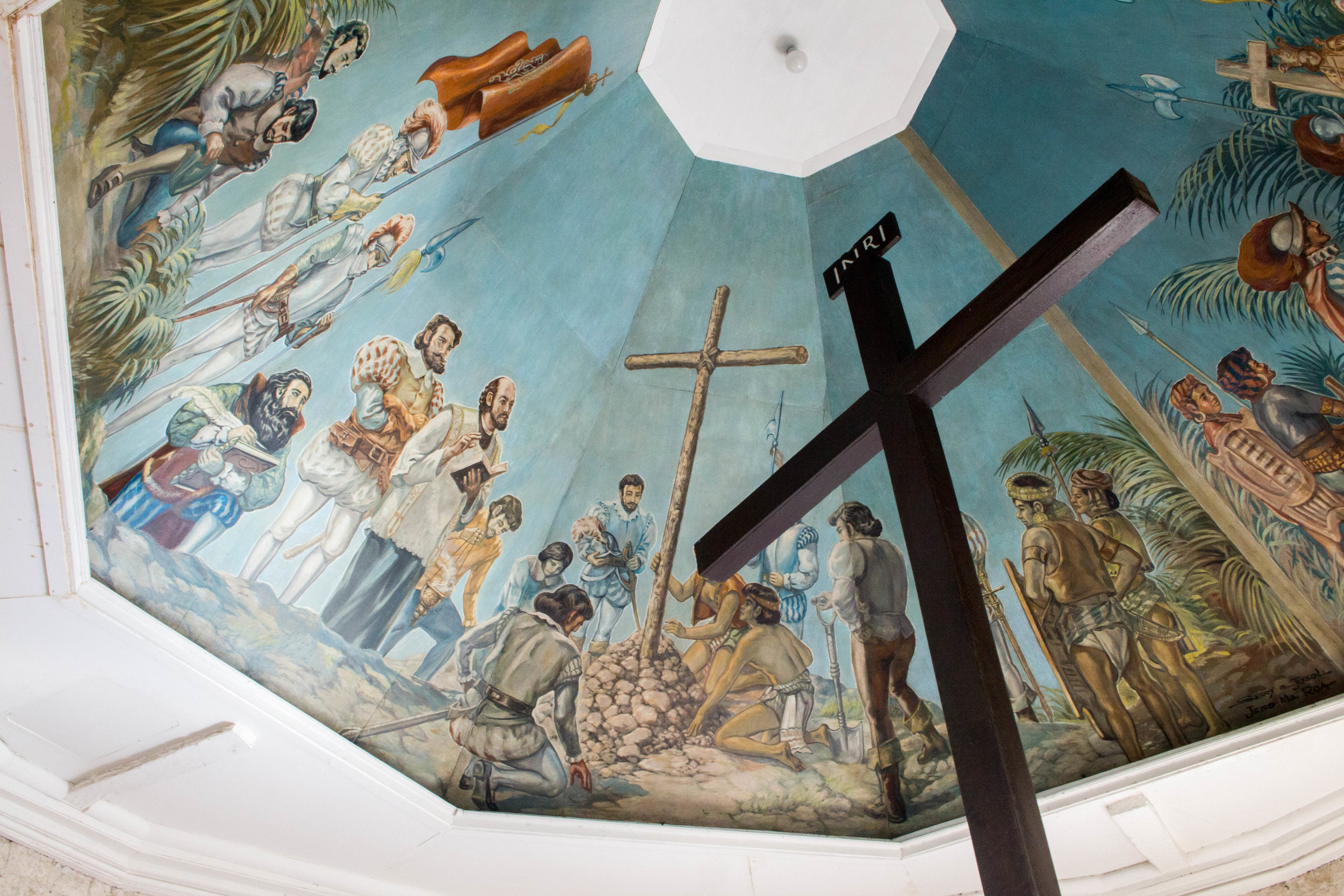 a reconstruction of magellan's cross--the original cross is buried in stone underneath