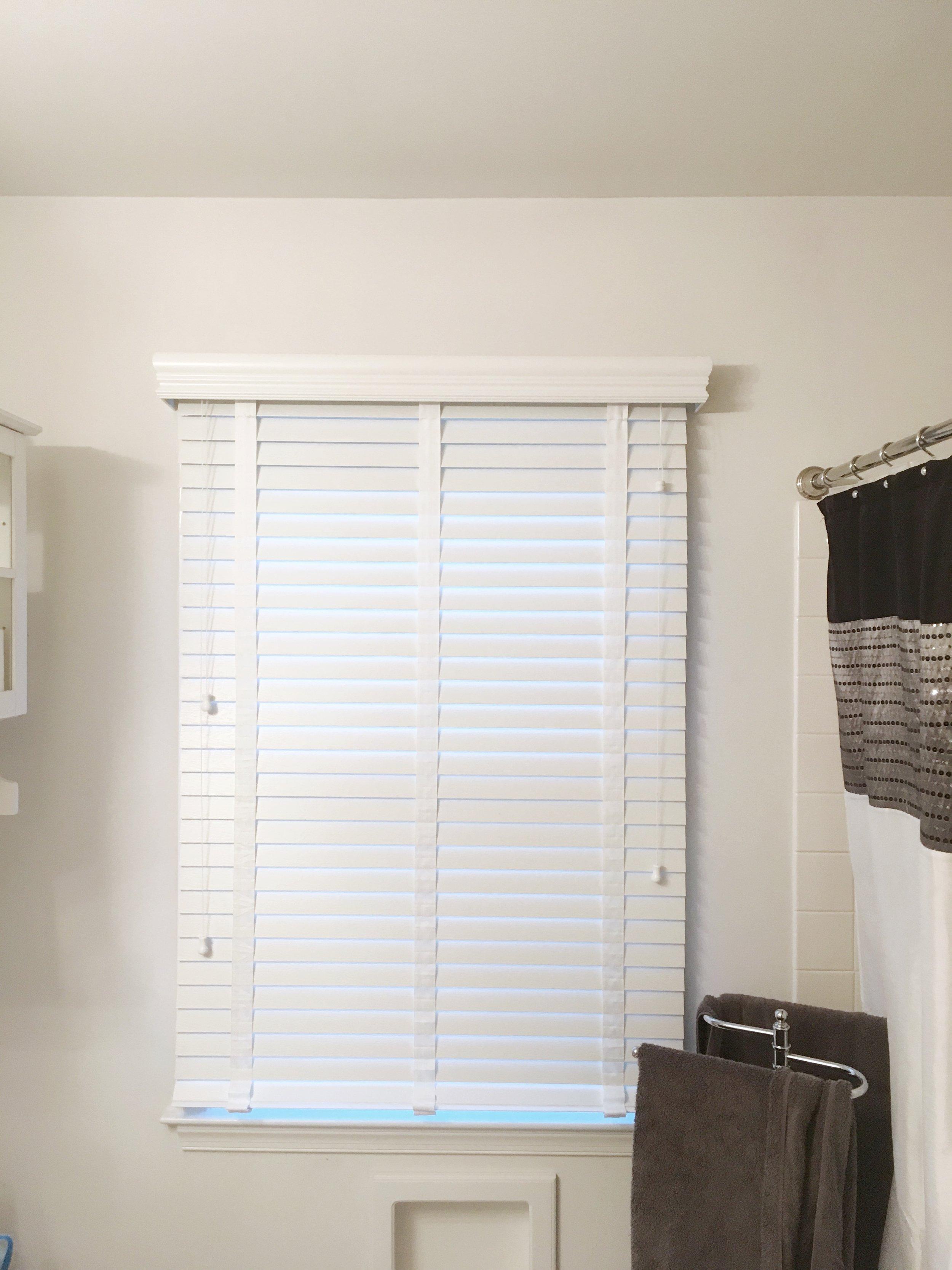 Custom white window blinds in bathroom by 3rdGenBlinds