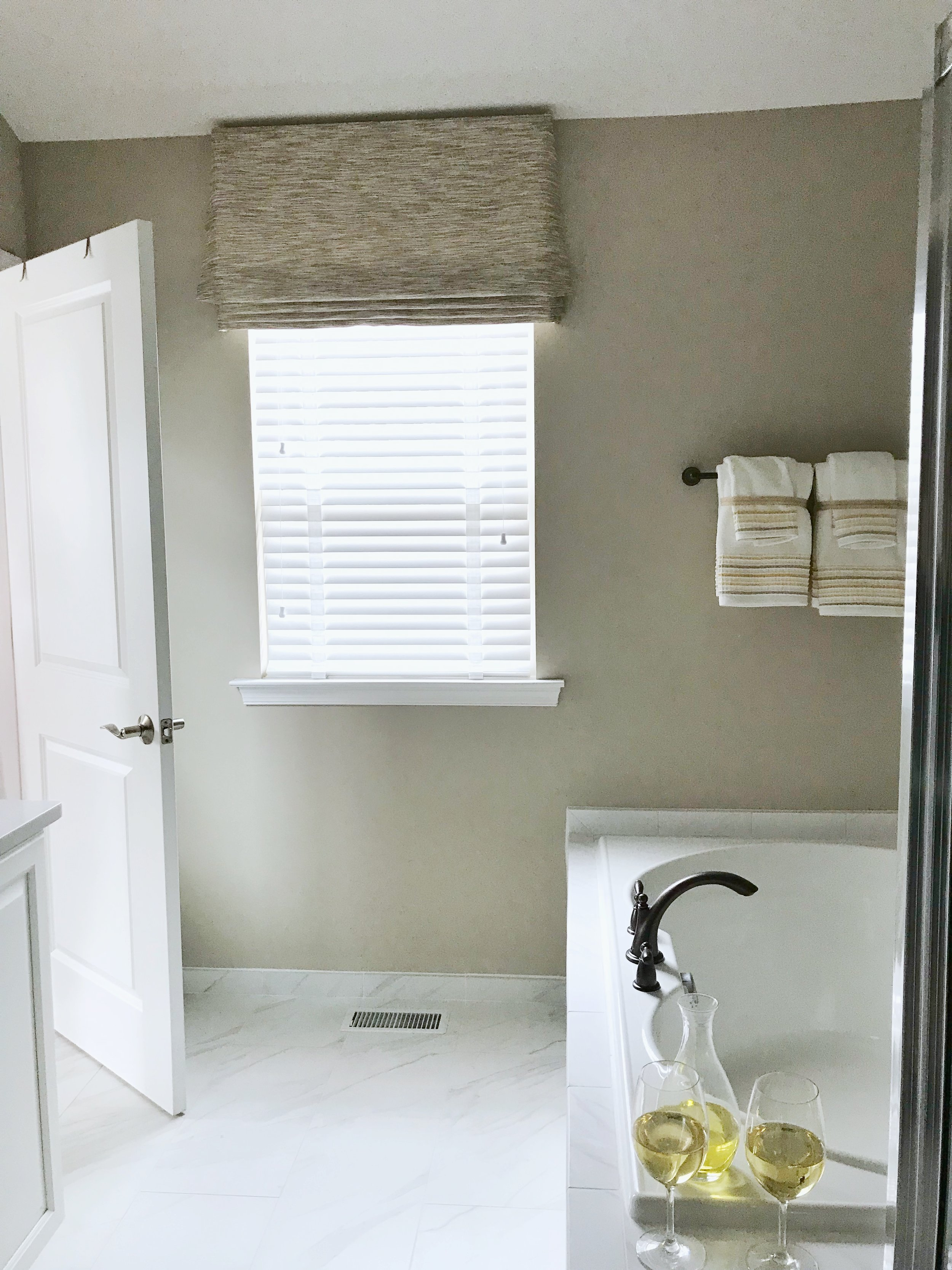 White custom window blinds in master bathroom by 3rdGenBlinds