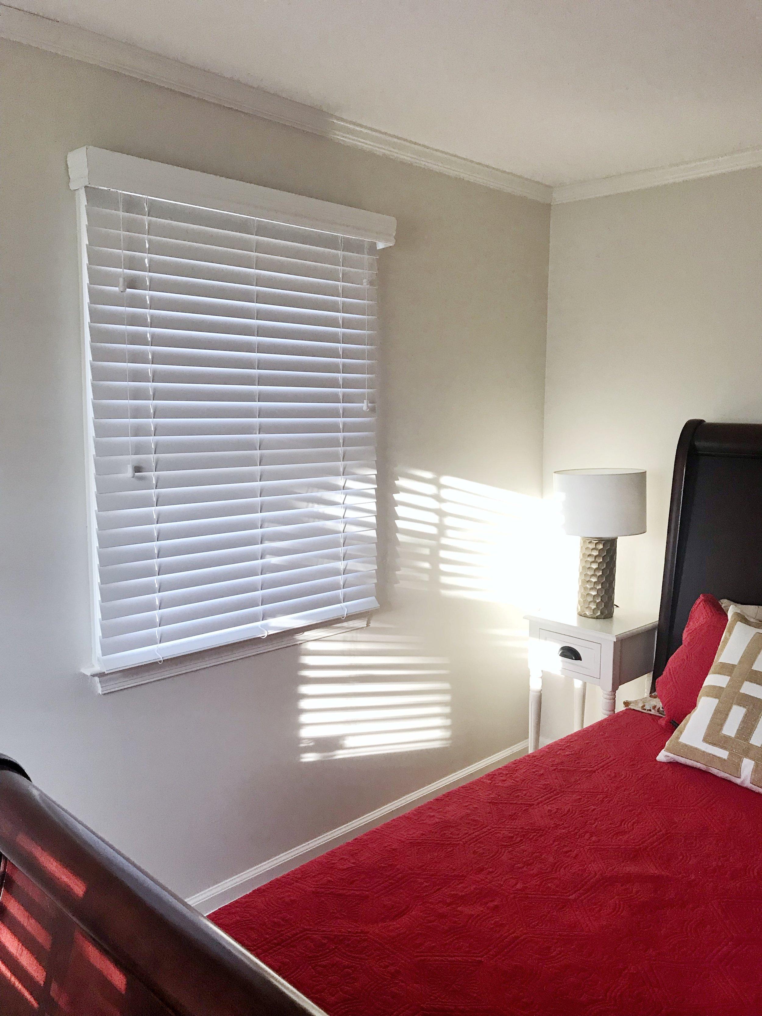 Guest bedroom custom white window blinds by 3rdGenBlinds