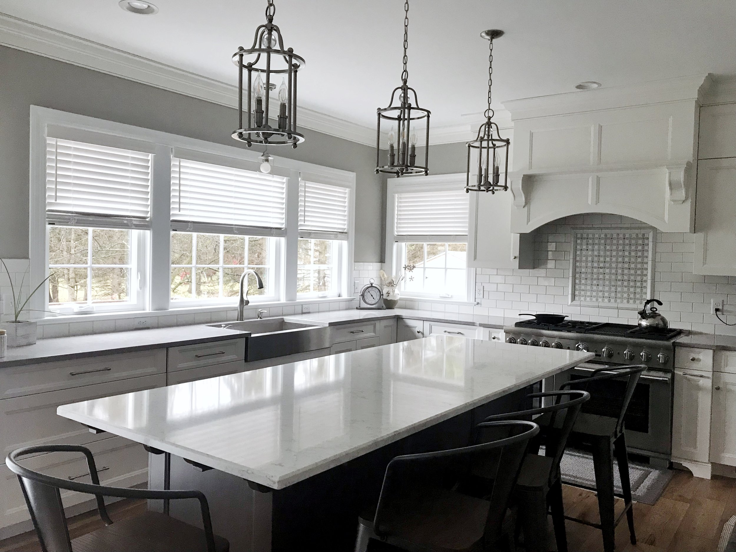 Custom white window blinds in kitchen by 3rdGenBlinds