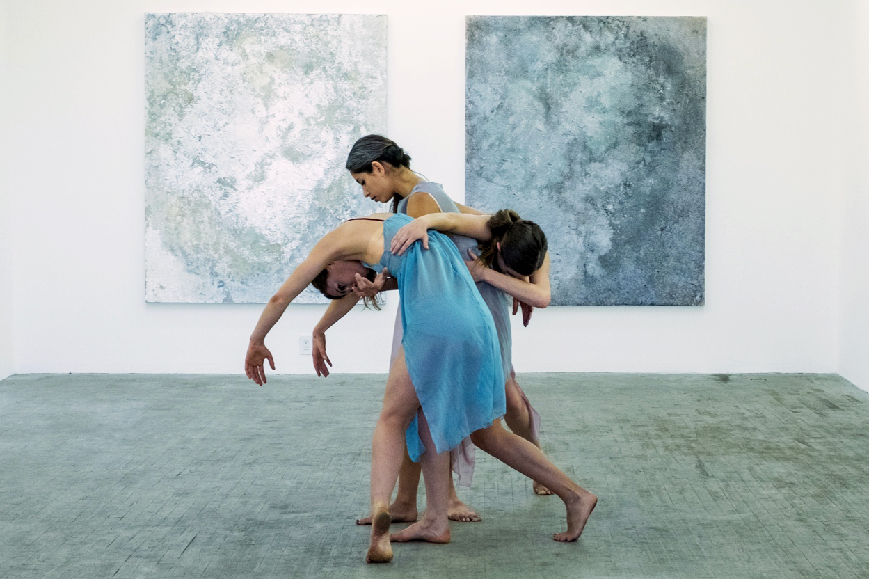 A moment from Multitudes in B Major, choreographed by Thea Bautista (center) + performed with Sarah LeGuenno (left) + Catherine Walsh (right). Image courtesy of Prelude Projects.
