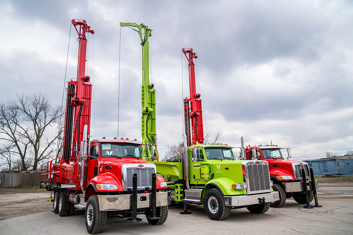 A new group of Versa-Drills rigs, freshly painted and ready for the job.