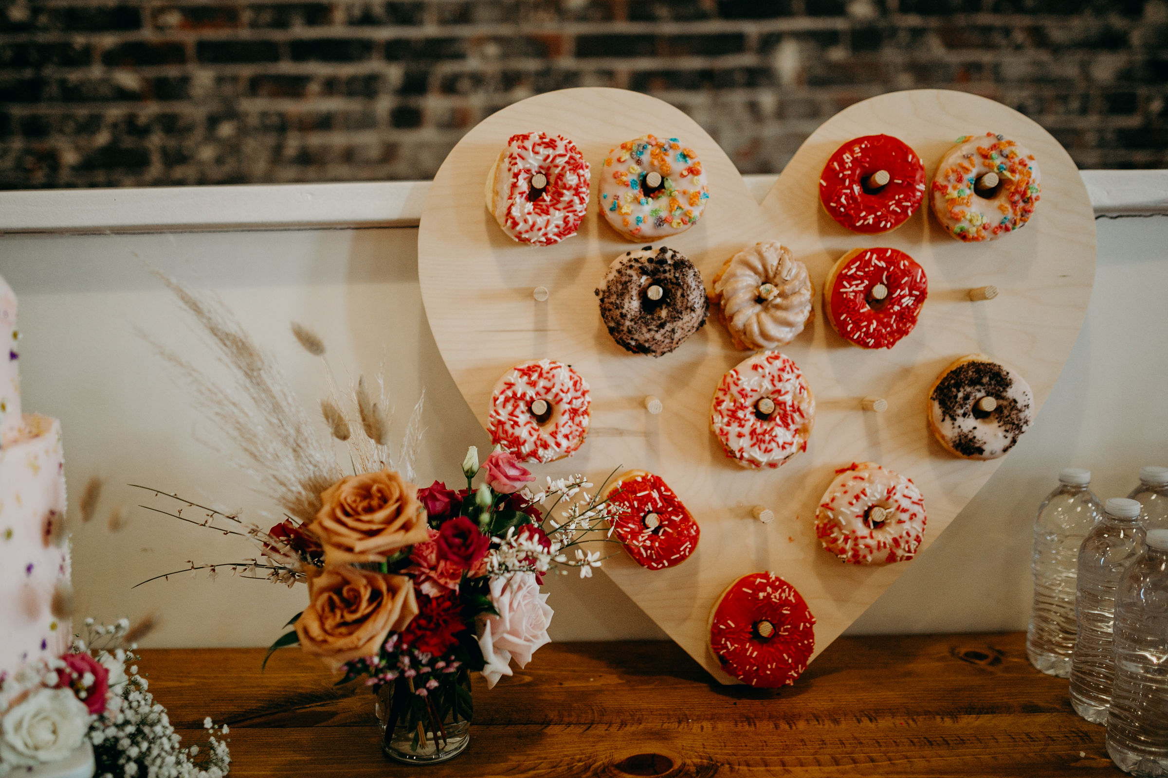 Photo:   Deltoro Photo  |  Donut Wall:     Dear Heart Signs  |  Florals:  I Dew Flowers