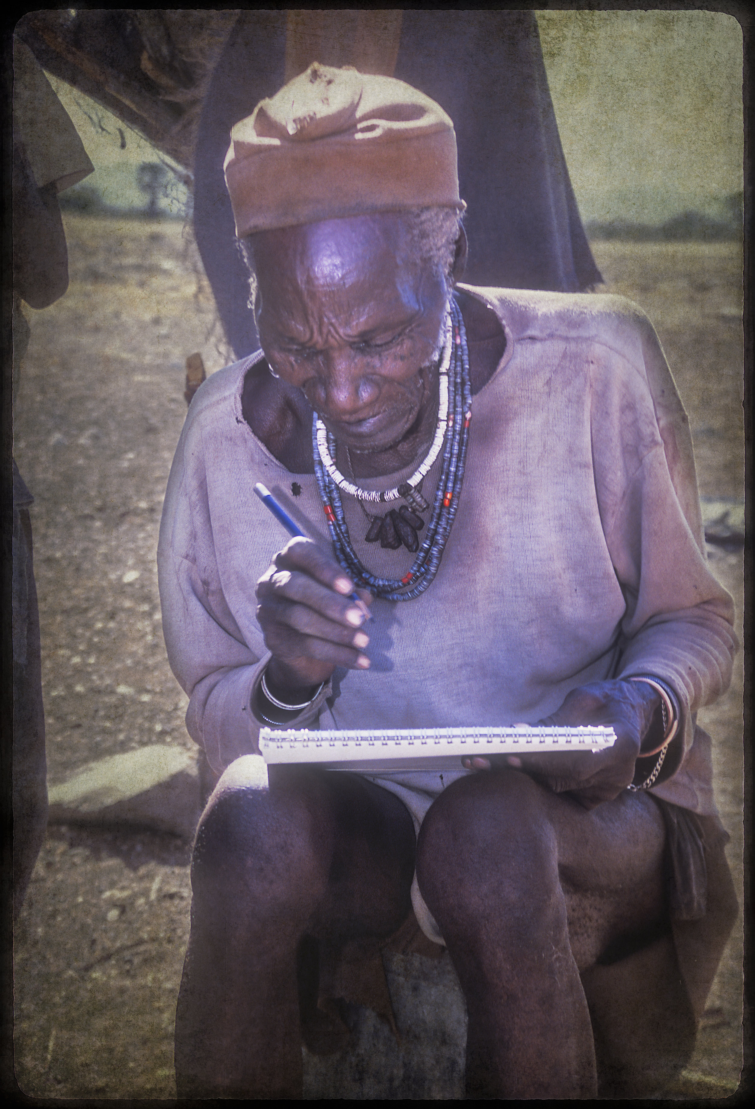 Himba medicine man draws his vision during trance