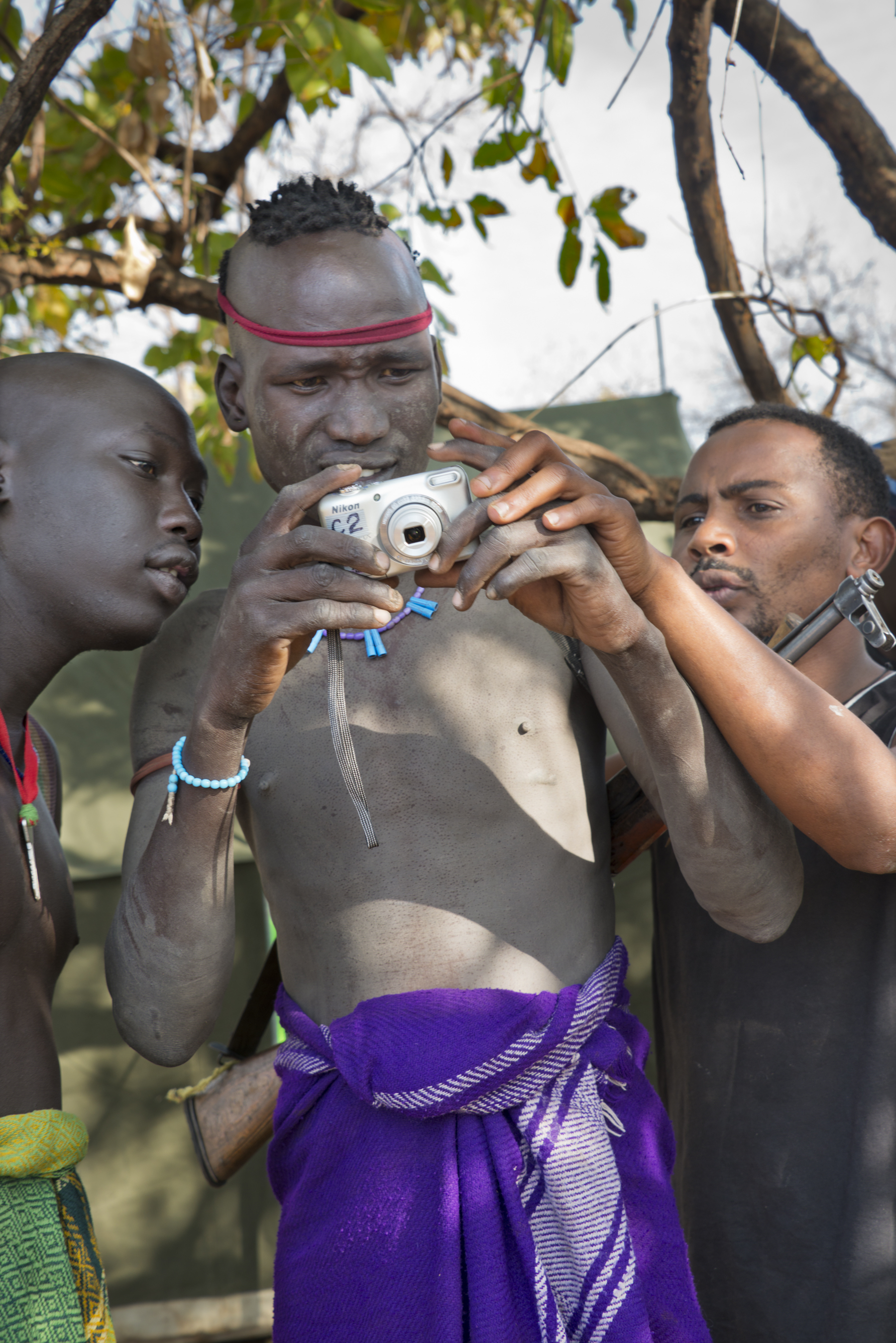 Mursi warriors learn photography