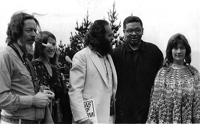 At the AUM Conference, Kurt, in white, holds a copy of Brown's book; to the far left is Alan Watts.