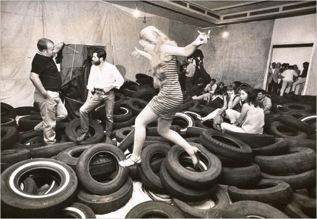 """Allan Kaprow's installation of tires invited participation, the creation of a """"happening."""""""