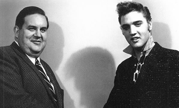 Elvis with Steve Sholes, RCA Victor's specialty record chief.