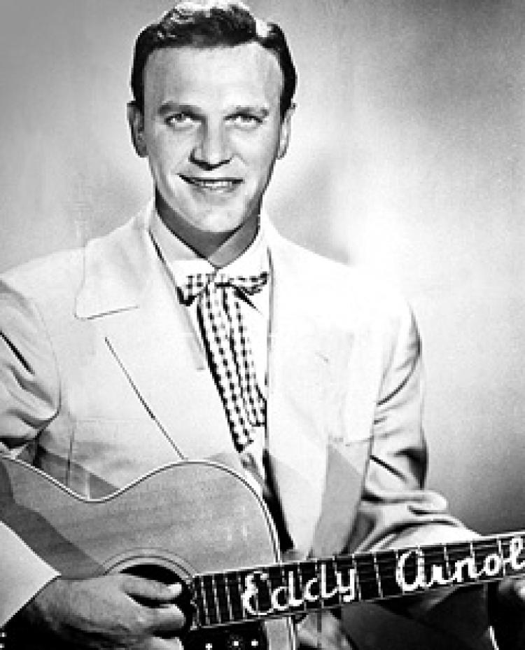 C&W singer Eddy Arnold was voted most popular in a disk jockey poll of 1956.