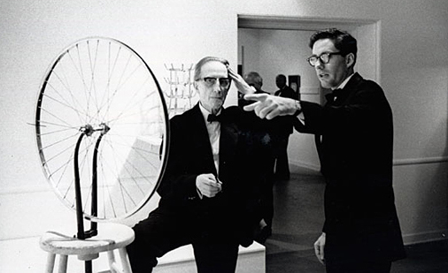 Duchamp with  Roue de bicyclette ; top his right is curator Walter Hopps.