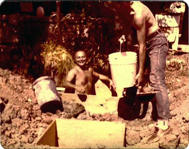 Here's Kurt looking as happy as a proverbial pig in shit while helping to install a new septic system at the ranch in the early 70s.