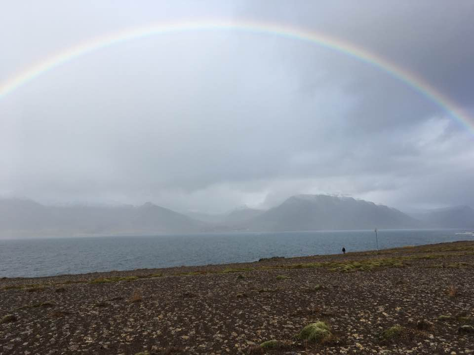 One of the many rainbows. For perspective, I'm that tiny black dot on the beach.