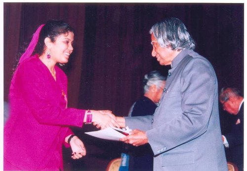 SILVER MEDAL FROM THE PRESIDENT OF INDIA. NEW DELHI. 2003. - With the late Dr. APJ Abdul Kalam, President of India (at the time) at an award ceremony; Received a medal in fiction-writing upon being selected from roughly 400,000 participants across 78 nations in the Shankar's International Writing Competition.