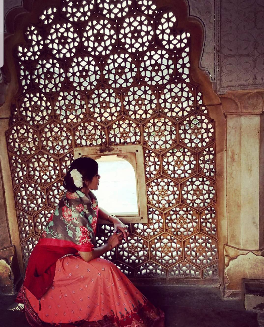 AMBER FORT PALACE, JAIPUR. INDIA. 2018 - I am seen in the exact same spot where Mughal emperor Akbar's wife Jodhaa was portrayed as gazing down into the courtyards in the 2008 Bollywood blockbuster Jodhaa Akbar, starring Aishwarya Rai and Hrithik Roshan. This picture was taken during a tour in Jaipur amid the five-day Jaipur Literature Festival extravaganza that I was invited to, in 2018.KEYWORDS: Jaipur Lit Fest, ZEE JLF, Jaipur Literature Festival, Jaipur, Authors, Nish Amarnath, HarperCollins, Amber Fort Palace, Bollywood blockbusters, Jodhaa Akbar, Mughal, Hrithik Roshan, Aishwarya Rai.