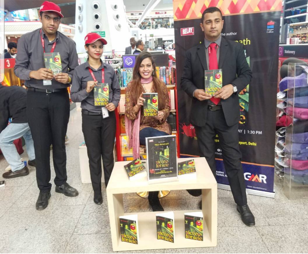 RELAY INDIA - AIRPORT LAUNCH, DELHI. 2018 - With the team at Relay india during an airport launch and signing of Victims For Sale in Delhi.KEYWORDS: RELAY India, bookstores, author events, Delhi airport, Nish Amarnath, Nischinta Amarnath, Victims For Sale.