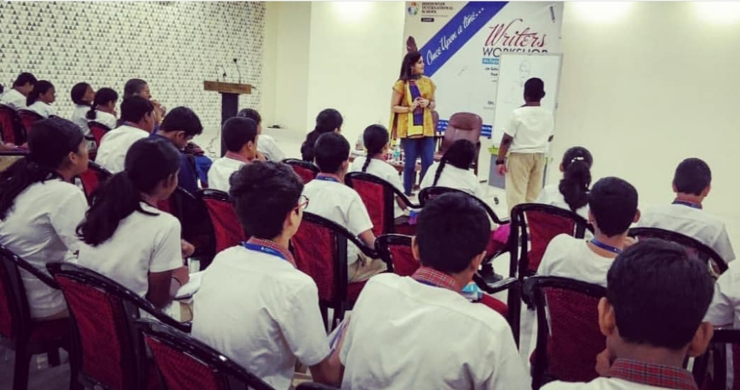 Hindustan International School (Cambridge IGCSE). Jan. 2019 - Addressing students (sixth-grade through tenth-grade) about the art of fiction-writing, storytelling and narrativization. On this photo, a seventh-grade student is seen participating actively in the storytelling process as others observe.KEYWORDS: Fiction, fiction authors, fiction-writing, storytelling, writer's workshop, creative writing, Hindustan International School, Cambridge IGCSE, Cambridge University Press, Nish Amarnath, Nischinta Amarnath