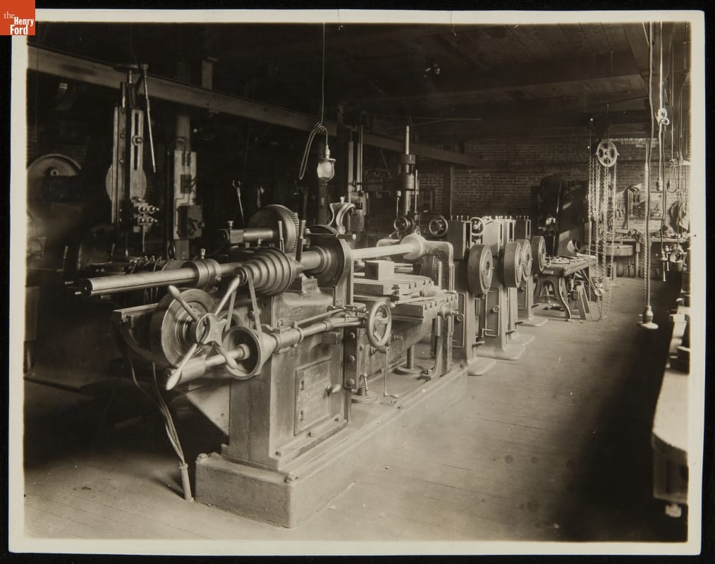 Armington & Sims Engine Co. Providence, Rhode Island, c. 1900.Inside the machine shop, a system of shafts and pulleys distributed mechanical energy to rows of metal working machine tools. The machinists who worked in shops like this could tackle a wide range of jobs making America's nineteenth century machine shops a training ground for many technological innovators.Source:  The Henry Ford Collection