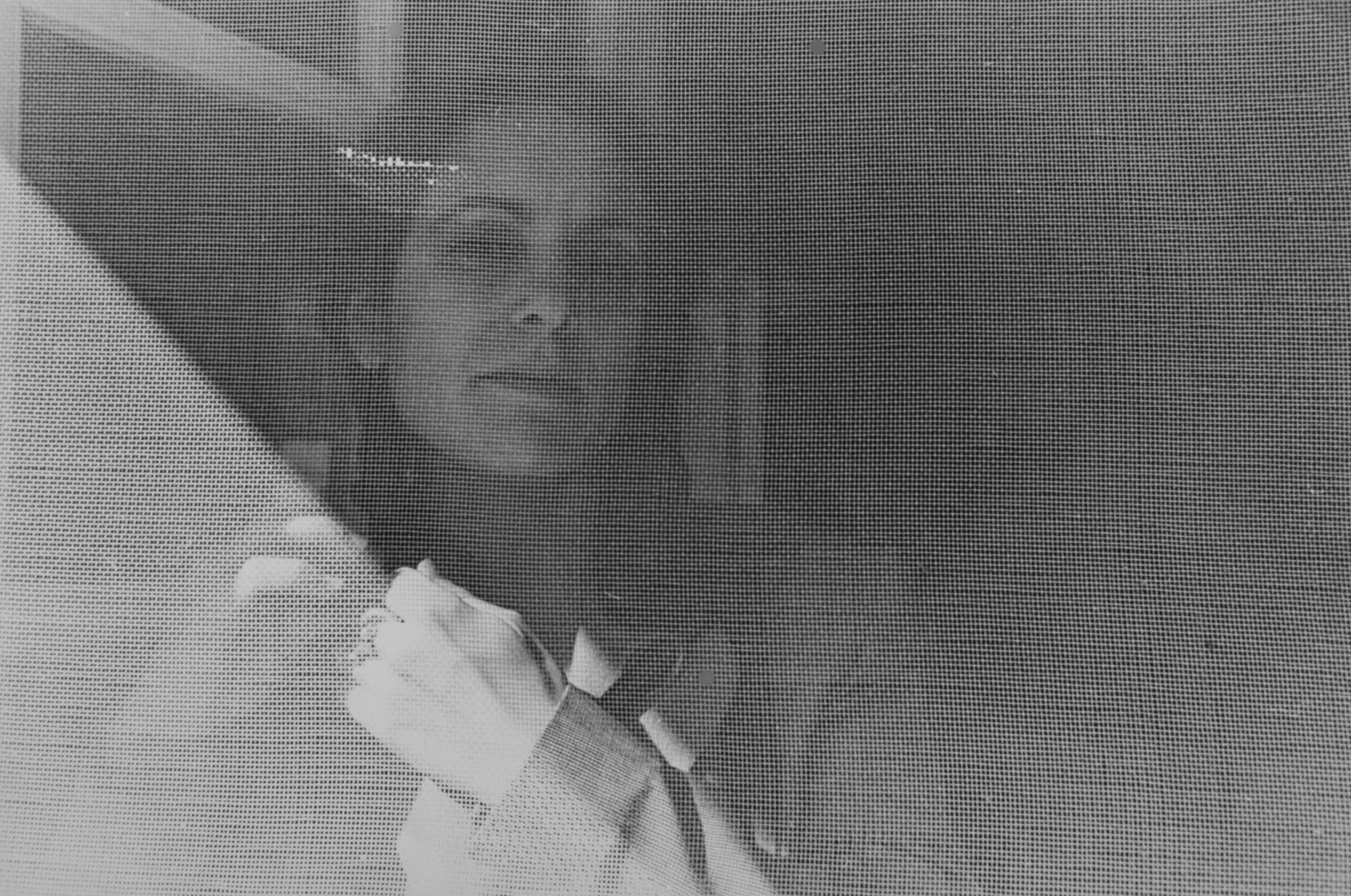 Susan behind the screen door