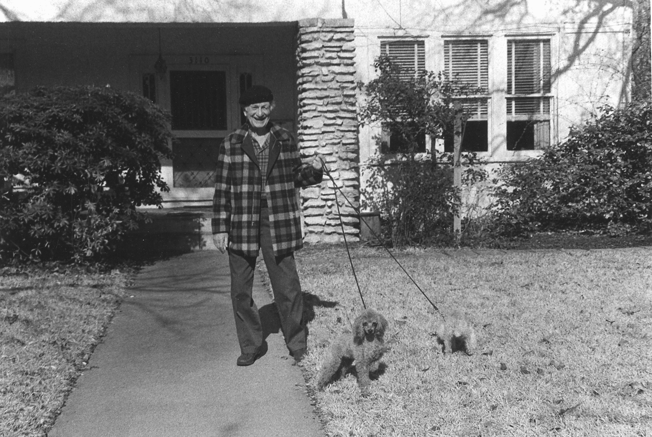 Russell Lee with his dogs, 1980