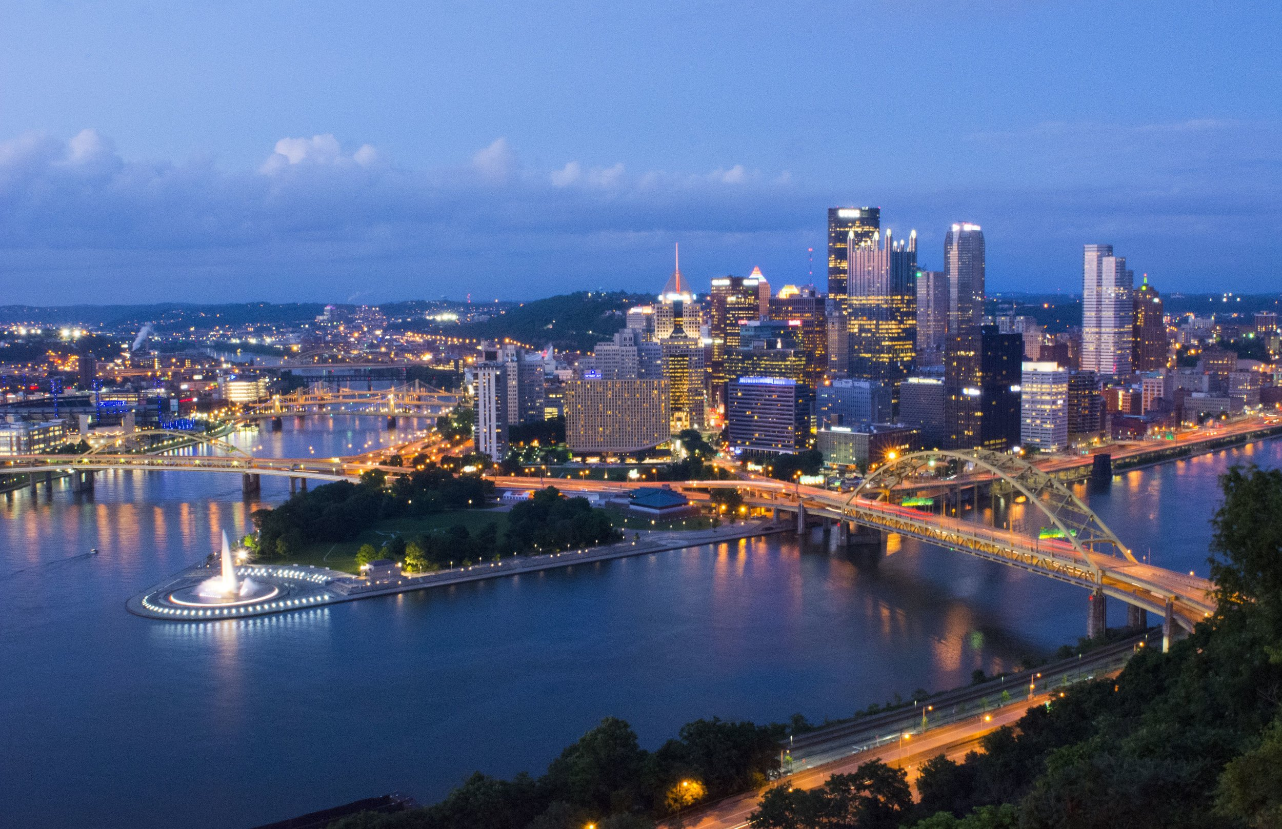 pittsburgh-pennsylvania-skyline-from-mt-washington-of-downtown-city-and-rivers-at-golden-triangle-at-night-exposure-of-three-rivers-and-fountain-at-point-547077117-58eb946f5f9b58ef7e1d2320.jpg