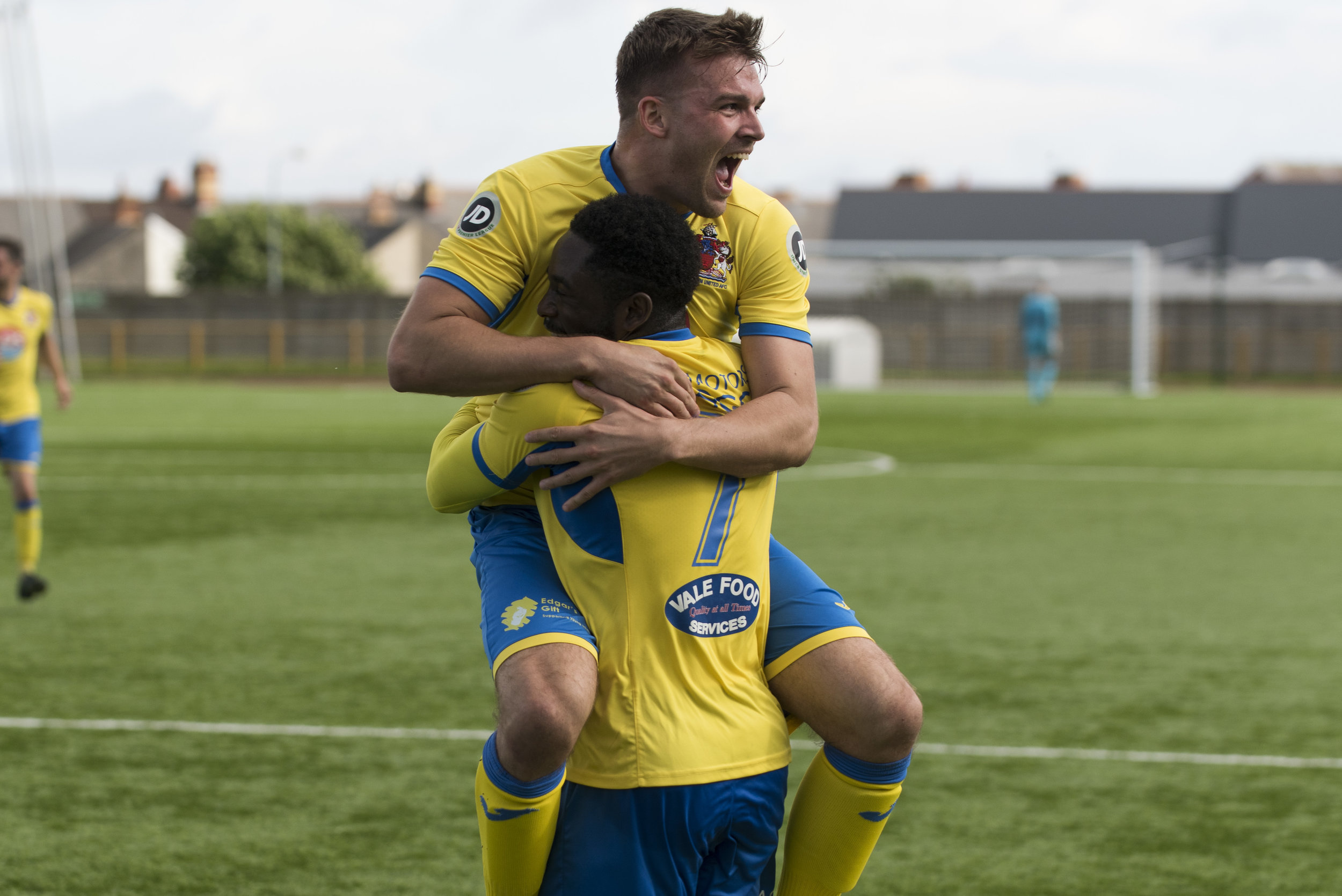Man of the Match Luke Cooper celebrates with McLaggon after his second goal