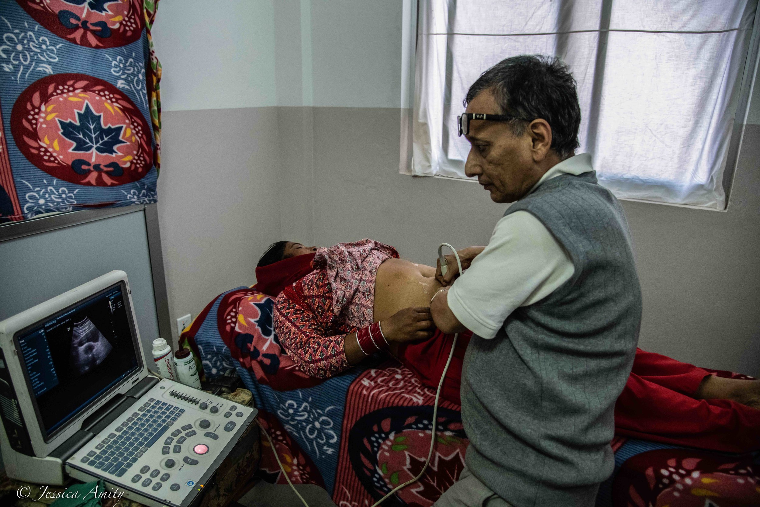 Dr. Suman gives a woman an ultrasound and discovers she has a tumour on her uterus. It would require her to visit a hospital and have it removed.